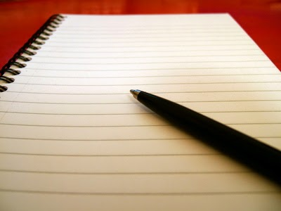 lined paper with pen